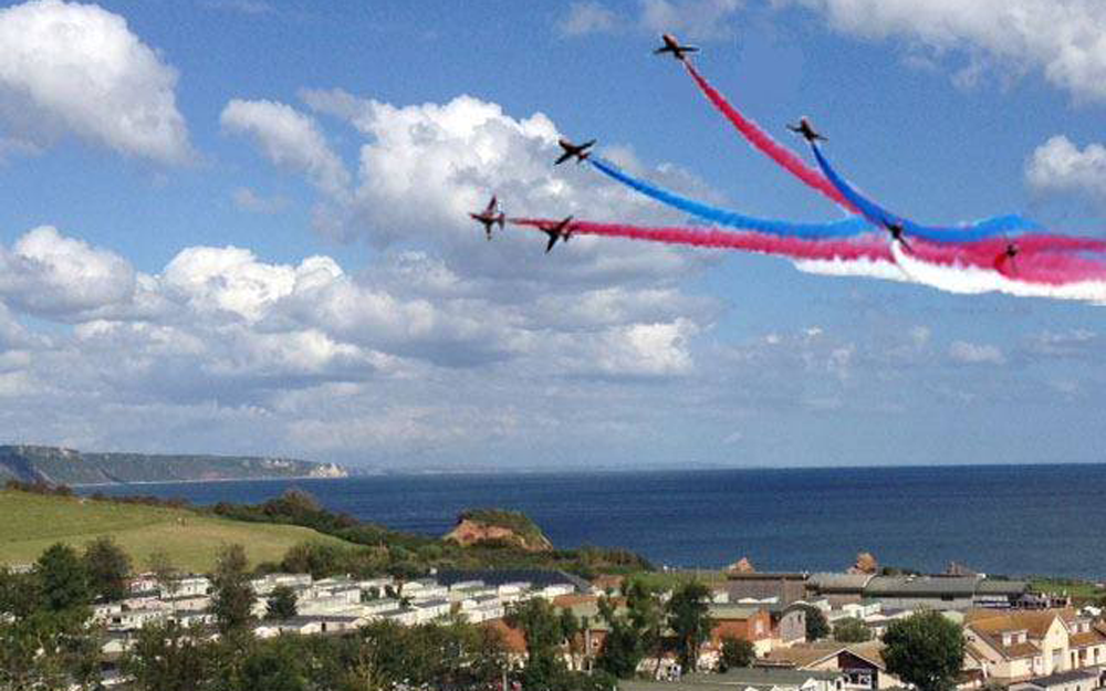 Red Arrows fly over Ladram Bay