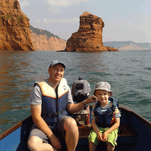 father and son in boat at Ladram Bay