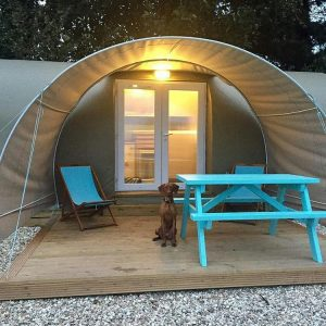 glamping pods with blue chairs